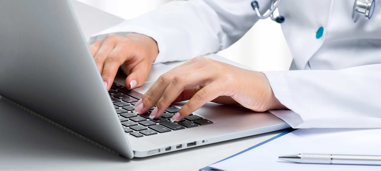 medical professional uses a computer